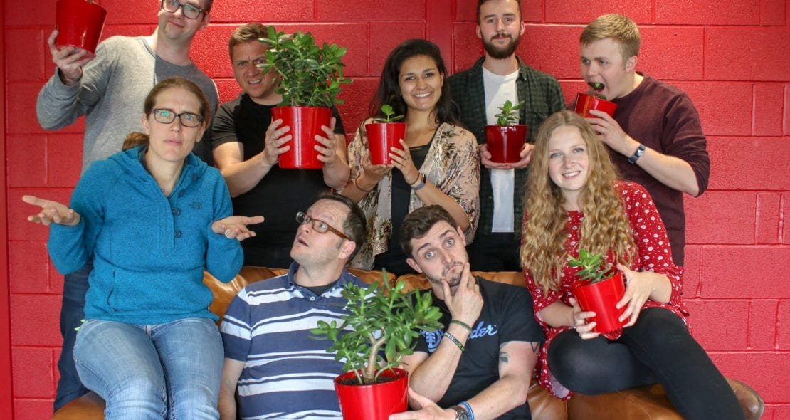 PopUp Business school Team holding plants.
