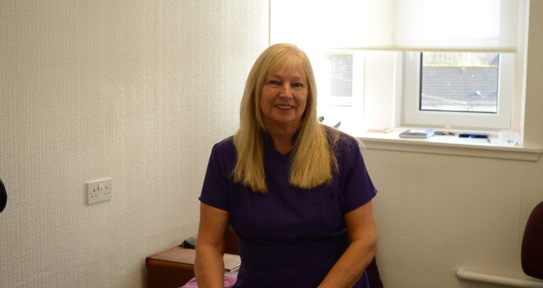 Barbara Elrick Massage practitioner in her treatment room.